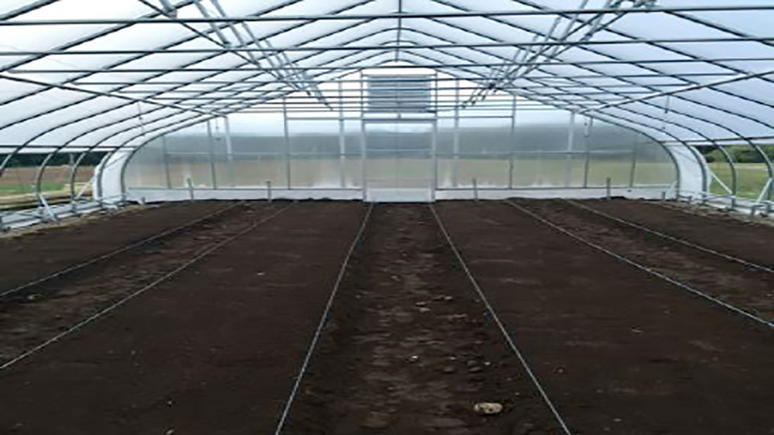 A Picture representing the UNH greenhouse where the conducted research on winter spinach production